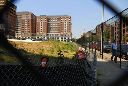A long-vacant lot in the 3200 block f St. Paul Street, seen here in 2007, will be developed by Johns Hopkins University as a mixed-use project with retail and residential. But some residents are objecting to the idea of a grocer as an anchor, saying it could put Eddie's of Charles Village across the street out of business.