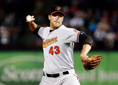 Former Orioles relief pitcher Jim Johnson throws to the Rangers in a game in Arlington, Texas Aug. 21, 2012.