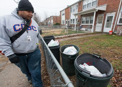 Dan Purdie, known as Big Dan the Pest Man, walks along a street in Riverview in February scoping out possible rat holes in peoples yards. Food waste/trash discarded on the ground and open-top trash cans are big problems in Riverview, which is directly contributing to the infestation problem. Baltimore County will begin eradication measures for rat infestations that have plagued Riverview. No procedures were done on Monday due to the rainy weather.