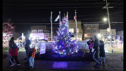 The annual Hampstead Christmas Tree Lighting Ceremony and Holiday Banner Display event will be held at Main Street Memorial Park on Friday. Last year's event is pictured.