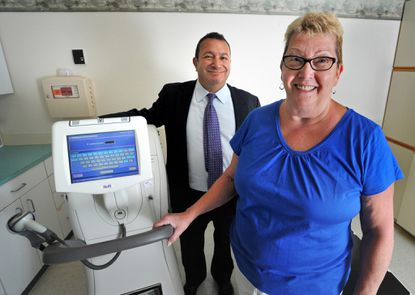 Marlene MacGregor, 70, of Perry Hall, a breast cancer survivor, with Dr. Maen Farha, the Medical Director of The Breast Center at Medstar Union Memorial Hospital. At left is the portable IORT machine.