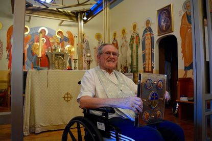 The Rev. Conan Timoney, leader of Patronage of the Mother of God Church in Arbutus, uses a wheelchair after suffering a spine injury. He expects to make a full recovery.