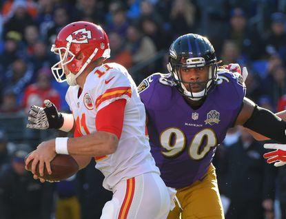 Ravens' Za'Darius Smith chases down Chiefs' quarterback #11 Alex Smith in the first quarter. Baltimore Ravens vs Kansas City Chiefs at M&T Bank Stadium.