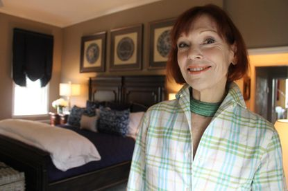 Paddy Dugan, of Lutherville, stands in the master bedroom she has designed for the 2017 Baltimore Symphony Orchestra's Decorators' Show House. The largest fundraiser for the BSO's educational programs opens Sunday through May 21.