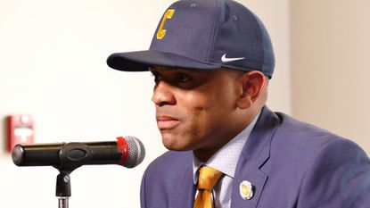 Juan Dixon is introduced as the new Coppin State men's basketball coach.