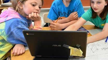 From left, Zoey Randolph, 9, Aiden Williamson, 10, and Gabrielle Campbell, 10, work together on Chromebooks in Trena Kregel's fourth grade class at Oliver Beach Elementary School.