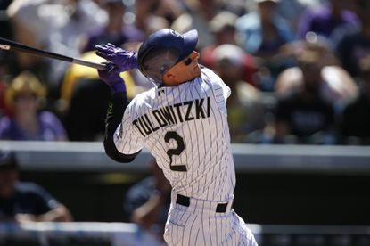 Shortstop Troy Tulowitzki bats against the Atlanta Braves in the third inning. Tulowitzki has been traded from the Colorado Rockies to the Toronto Blue Jays.