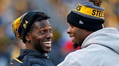 Steelers wide receiver Antonio Brown, left, and running back Le'Veon Bell celebrate on the sideline after a Steelers touchdown during the second half of a game against the Cleveland Browns on Jan. 1.