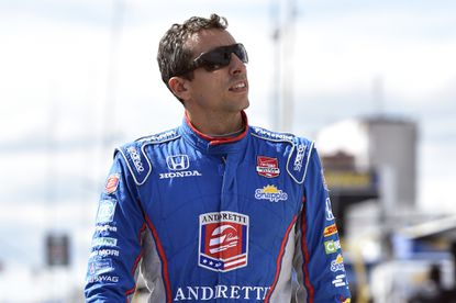 This Aug. 22, 2015, file photo shows Justin Wilson, of England, walking on pit road during qualifying for Sunday's Pocono IndyCar 500 auto race. Wilson has died from a head injury suffered when a piece of debris struck him at Pocono Raceway. He was 37.