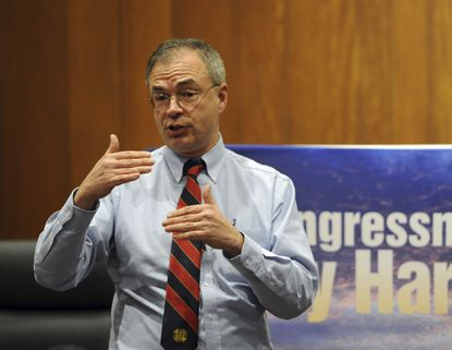 Rep. Andy Harris speaks to the audience at a town hall meeting in Bel Air.