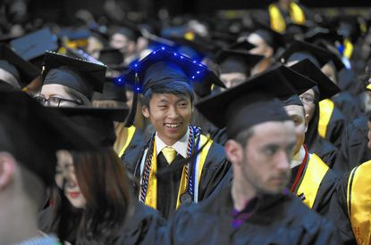 Jaeyoung Yang, Cume Laude, Emergency Health Services, wears an illuminated graduation cap at the UMBC commencement.