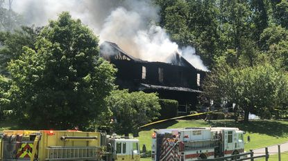 Howard County fire crews are battling a house fire in Woodbine on Tuesday.