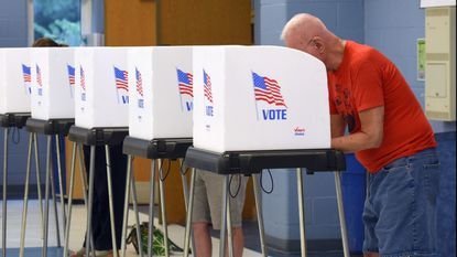 Voters cast their ballots at Stoneleigh Elementary School in Baltimore County soon after the polls opened Tuesday.