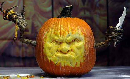 Ray Villafane created this carved pumpkin at the Maryland State Fair Friday.