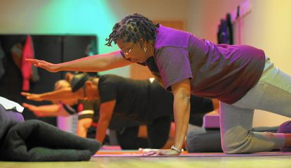 Maxine Bigby Cunningham attends yoga classes twice a week at Lifebridge Health and Fitness as part of her treatment for seasonal affective disorder.