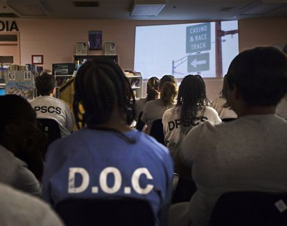 "Inmates at the Maryland Correctional Institute for Women in Jessup watch thed ocumentary ""Understanding Joy: The Devastation of a Gambling Addiction,"" the story of a fellow inmate."