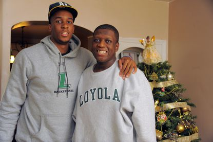 Loyola basketball player Jordan Latham (City), left, poses for a picture with his brother, Myles, who has autism.