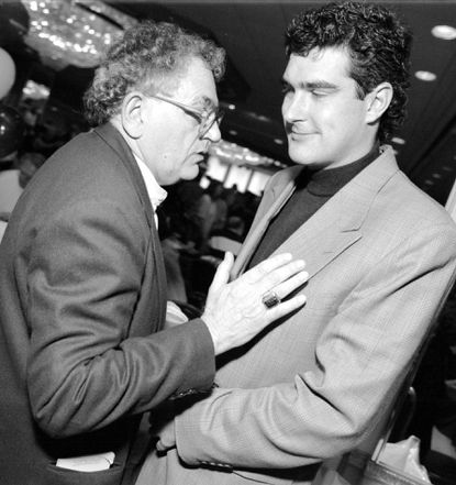 Jim Phillips (left) is seen at a Baltimore Colts Corral sponsored benefit in 1996.