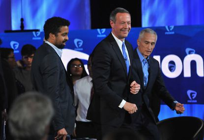 DES MOINES, IA - JANUARY 11: Journalists Rembert Browne and Jorge Ramos with democratic presidential candidate Martin O'Malley (C) pictured onstage during the FUSION presents the Brown & Black Democratic Forum at Drake University on January 11, 2016 in Des Moines, Iowa. (Photo by Fernando Leon/Getty Images for Fusion) ORG XMIT: 596340397