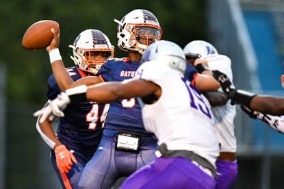 Reservoir quarterback Malcolm Brown (5), seen against Long Reach earlier this season, threw for a school-record 414 yards and four touchdowns against Oakland Mills on Friday.