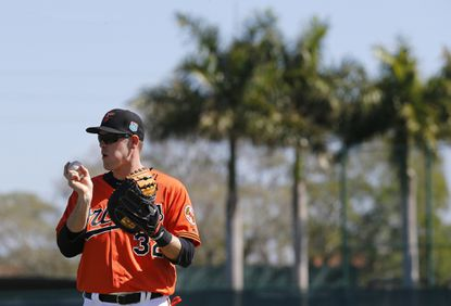 Baltimore Orioles catcher Matt Wieters stands on a field during a spring training baseball workout in Sarasota, Fla., Friday, Feb. 19, 2016. (AP Photo/Patrick Semansky)