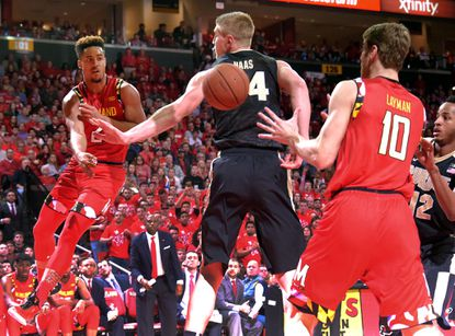 Maryland guard Melo Trimble (2) passes behind the back of Purdue Boilermakers center Isaac Haas to forward Jake Layman (10) during the second halfin College Park on Feb. 6, 2016.