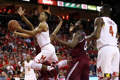 Maryland guardMelo Trimble drives to the basket past Kahlil Thomas of the Rider Broncs during the second half at Xfinity Center on Nov. 20, 2015 in College Park.