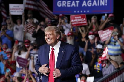 In this Sept. 8, 2020, file photo President Donald Trump stands on stage after speaking at a campaign rally at Smith Reynolds Airport in Winston-Salem, North Carolina.
