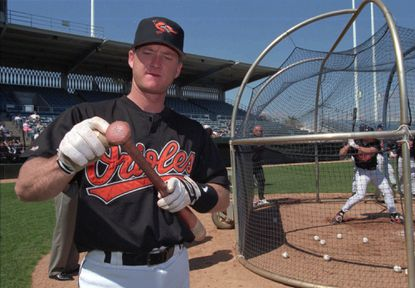 Orioles catcher Gregg Zaun uses pine stick on his bat before stepping into the batting cage during the Orioles' spring training at Fort Lauderdale Stadium on Feb. 18, 1996.