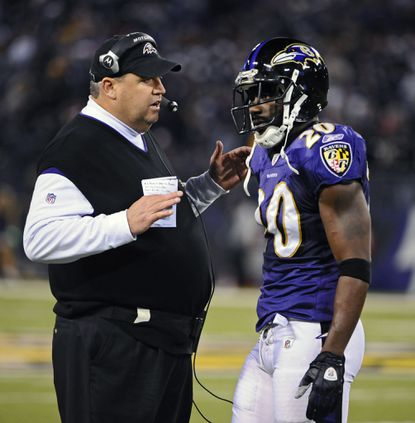 Ravens defensive coordinator Rex Ryan, left, is pictured talking with safety Ed Reed in a game against the Steelers on Dec. 14, 2008.