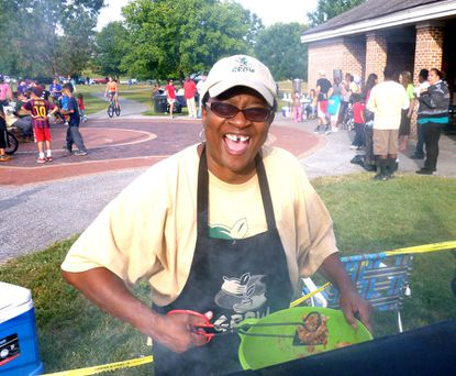 Darcel Harris was all smiles Sept. 15 as she answered questions, cooked hamburgers and hot dogs and helped coordinate activities for over 300 folks who attended the 11th annual Pennsylvania Avenue ¿ Tristreet Association block party in Dutterer Family Park in Westminster.