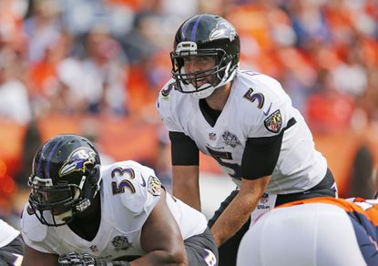Ravens quarterback Joe Flacco lines up under center Jeremy Zuttah (53) during a game against the Denver Broncos. Zuttah missed the end of the Ravens' Week 8 win over the San Diego Chargers with a sprained shoulder, but returns against the Jackonsville Jaguars.
