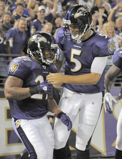 Joe Flacco celebrates the touchdown run of running back Ray Rice in the second quarter.
