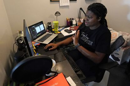 Chicago charter school teacher Angela McByrd teaches remotely from her home in Chicago,