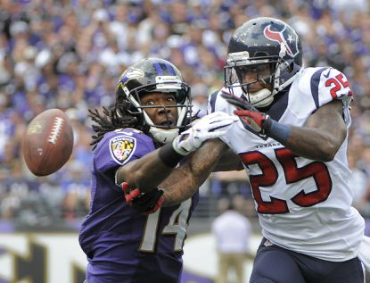 Ravens wide receiver Marlon Brown can't make this second-quarter catch because of pass interference on Houston's Kareem Jackson during their Sept. 22 game last year.
