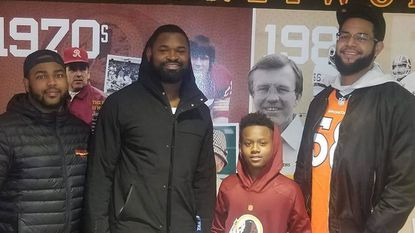 New Howard County Terps president Vaughn Stamper (left) poses with Washington Redskins linebacker and former Wilde Lake football star Zach Brown (middle left), Howard County Terps athlete Max Richardson (middle right) and assistant coach Cody Blue.