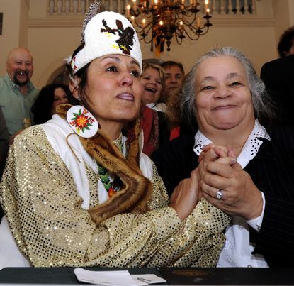 Natalie Proctor, left, and Mervin Savoy, both tribal chairs, at the signing of the executive orders.