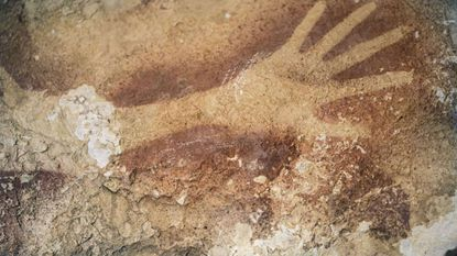 A stencil of a hand found in a cave on the Indonesian island of Sulawesi is about 40,000 years old, say archaeologists, making it the oldest piece of graffiti on record.