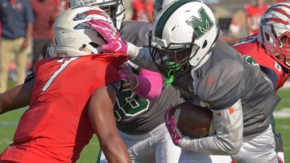Milford Mill running back Desmond Shell breaks a tackle attempt by Franklin linebacker Jay Thompson to score a touchdown in the Millers' 26-21 win Oct. 14. Both players made the All-Baltimore County offensive and defensive teams.