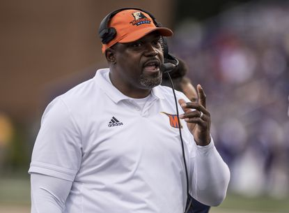 Morgan State head coach Tyrone Wheatley talks with his assistants during the first half of an NCAA college football game against James Madison in Harrisonburg, Va., Saturday, Sept. 14, 2019.