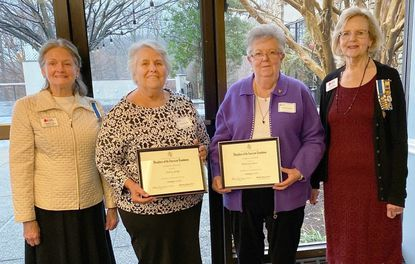 Glenda Force, left, and Gloria Day, right, both of the Timonium-based Colonel John Streett Chapter of the National Society of the Daughters of the American Revolution, present awards for their VA hospital service to Dolores Savage, second from left, and Hilda Lee Davis , third from left.