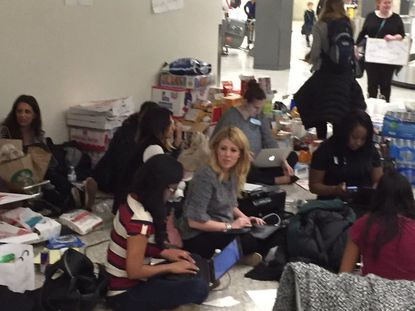 Democracy in Crisis: Lawyers at Dulles fight for travelers trapped by Trump's 'Muslim ban'