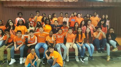 Students and staff at Dwight D. Eisenhower Middle School sported orange clothing on March 24 to remember Journey Butler, the daughter of seventh-grade reading teacher Camille Butler. during National Kidney Cancer Awareness Month.