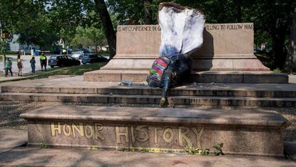 The Madre Luz statue, created by artist Pablo Machioli, stood on the pedestal that held the Lee-Jackson statue, but was found toppled on Thursday afternoon.