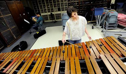 Westminster High School junior Cynthia Burgess practices on the marimba Tuesday. Burgess has been selected by Music for All to perform in the 2012 Honor Orchestra of America.