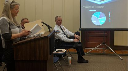 Sykesville Town Treasurer Evelyn Sweet presents the fiscal year 2020 capital improvement plan to the Mayor and Town Council on Feb. 25, 2019. Seated in the front row is police Chief Mike Spaulding.