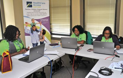 From left, Stephanie Baptiste, Jaime Thomas, and Pamela Williams are among the 14 new navigators who will help people sign up for insurance coverage with the Maryland Health Exchange.