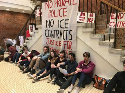 Johns Hopkins University students last year staged a sit-in to protest against an armed police force on campus. The university has now said it will hold off on plans for such a force.