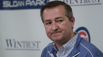 Chicago Cubs chairman Tom Ricketts answers questions during a news conference Monday in Mesa, Ariz.