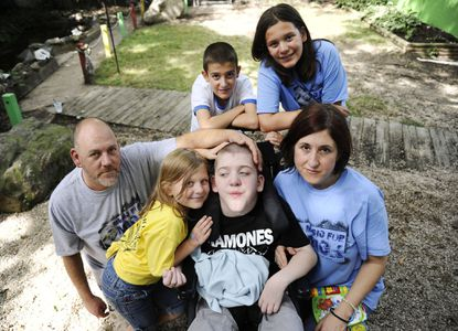 From top left, John Smith, 12, Grace Smith, 12, From bottom left, Michael Smith Jr., Martie Smith, 7, Mickey Smith, 12, and Cathy Smith, all of Gambrills. John, Grace and Mickey are triplets and siblings to Martie. Mickey has a progressive neuromuscular disease.